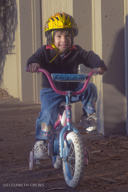 Berkeley CA Guatemalan girl, three and a half, learning how to ride bike  MR