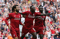 Liverpool's Mohamed Salah celebrates scoring his side's first goal with Naby Keita and Sadio Mane<br /> <br /> Photographer Rob Newell/CameraSport<br /> <br /> The Premier League - Liverpool v West Ham United - Sunday August 12th 2018 - Anfield - Liverpool<br /> <br /> World Copyright &copy; 2018 CameraSport. All rights reserved. 43 Linden Ave. Countesthorpe. Leicester. England. LE8 5PG - Tel: +44 (0) 116 277 4147 - admin@camerasport.com - www.camerasport.com