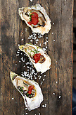 USA, California, Sausalito, BBQ oysters on the half shell at Fish restaurant