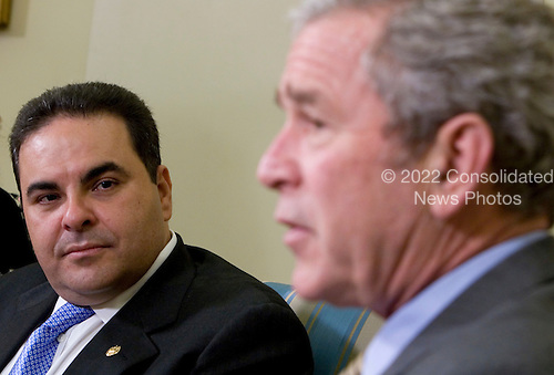 Washington, D.C. - December 16, 2008 -- United States President George W. Bush, right, meets with President Elías Antonio Saca González of El Salvador, left, in the Oval Office of the White House in Washington, D.C. on Tuesday, December 16, 2008..Credit: Kristoffer Tripplaar-Pool via CNP