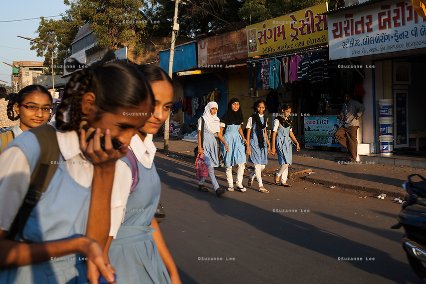 School girls giggle as they walk home from school in Anand, Gujarat, India on 12th December 2012.  Photo by Suzanne Lee / Marie-Claire France