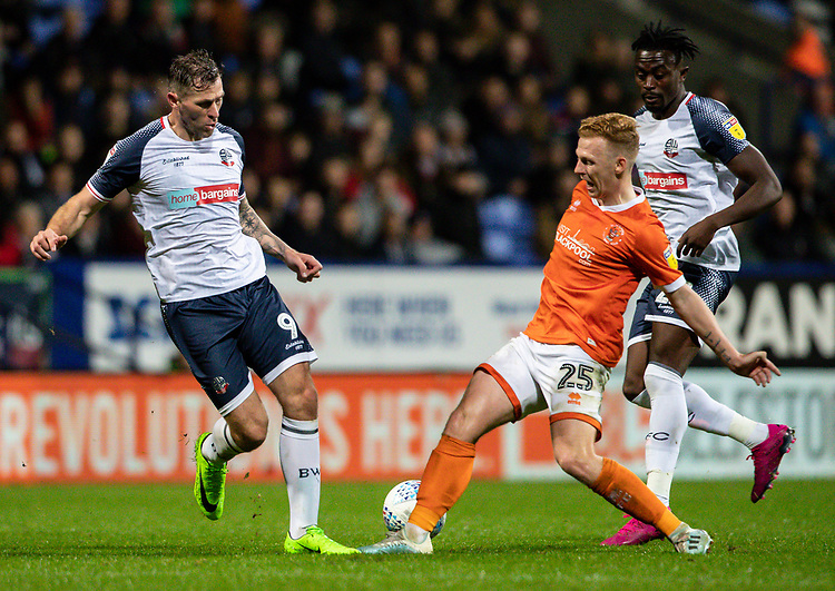 Bolton Wanderers' Daryl Murphy (left) competing with Blackpool's Callum Guy (centre) <br /> <br /> Photographer Andrew Kearns/CameraSport<br /> <br /> The EFL Sky Bet League One - Bolton Wanderers v Blackpool - Monday 7th October 2019 - University of Bolton Stadium - Bolton<br /> <br /> World Copyright © 2019 CameraSport. All rights reserved. 43 Linden Ave. Countesthorpe. Leicester. England. LE8 5PG - Tel: +44 (0) 116 277 4147 - admin@camerasport.com - www.camerasport.com