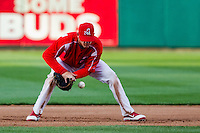 Ryan Jackson (23) of the Springfield Cardinals makes an error on a ground ball during a game against the Frisco RoughRiders on April 16, 2011 at Hammons Field in Springfield, Missouri.  Photo By David Welker/Four Seam Images