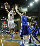 SIOUX FALLS, SD - NOVEMBER 30:  Cody Larson #34 from South Dakota State University shoots a short hook over Nate Hicks #1 from Florida Gulf Coast in the second half of their game Sunday afternoon at the Sanford Pentagon in Sioux Falls. (Photo by Dave Eggen/inertia)