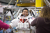 Houston, TX - January 28, 2009 -- Japan Aerospace Exploration Agency (JAXA) astronaut Koichi Wakata, STS-119 mission specialist, gets help in the donning of a training version of his Extravehicular Mobility Unit (EMU) spacesuit in preparation for a spacewalk training session in the waters of the Neutral Buoyancy Laboratory (NBL) near NASA's Johnson Space Center. Wakata is scheduled to join Expedition 18 as flight engineer after launching to the International Space Station with the STS-119 crew..Credit: Bill Stafford - NASA via CNP