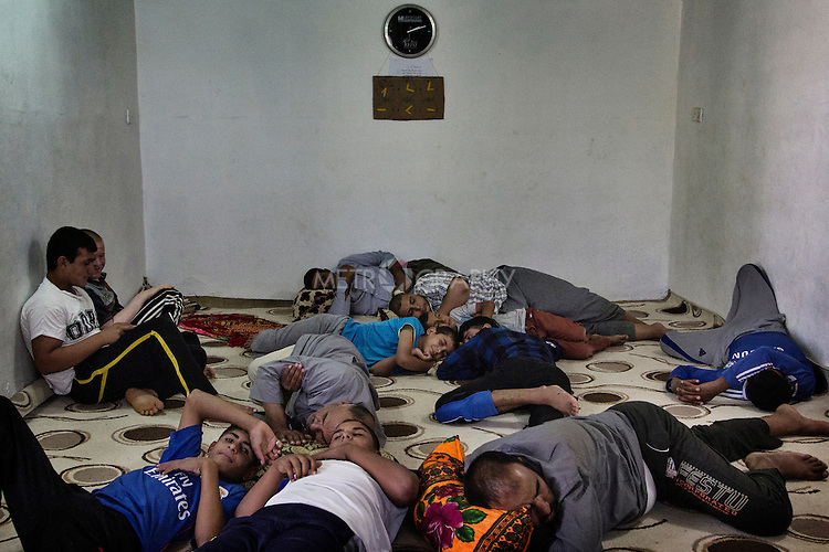 23/06/2015 -- Dibaga-Makhmur-, Iraq -- A group of men takes rest in a room which has been turned into a mosque, in a hot afternoon during the holy month of Ramadan. Temperature last summer reached 50 degrees during one of the worst heat wave ever registered in the middle east.