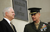 Arlington, VA - May 10, 2007 -- United States Secretary of Defense, Robert Gates, and the Chairman of the Joint Chiefs of Staff, Gen. Peter Pace, await the arrivial of the President of the United States, George W. Bush at the Pentagon on Thursday, May 10, 2007. <br /> Credit: D. Myles Cullen - DoD via CNP