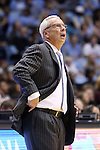 14 November 2014: UNC head coach Roy Williams watches a replay on the scoreboard. The University of North Carolina Tar Heels played the North Carolina Central University Eagles in an NCAA Division I Men's basketball game at the Dean E. Smith Center in Chapel Hill, North Carolina. UNC won the game 76-60.