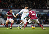 Barclays Premier League, West Ham United (red)V Swansea City Fc (white), Boelyn Ground, 02/02/13<br /> Pictured: Ki Sung Yueng<br /> Picture by: Ben Wyeth / Athena Picture Agency<br /> info@athena-pictures.com