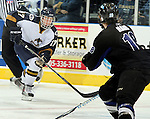 SIOUX FALLS, SD - JANUARY 1: Dominic Zombo #17 of the Sioux Falls Stampede looks to get past the defense of Garrett Haar #18 from the Fargo Force in the first period of their game Saturday night at the Arena. (Photo by Dave Eggen/Inertia)