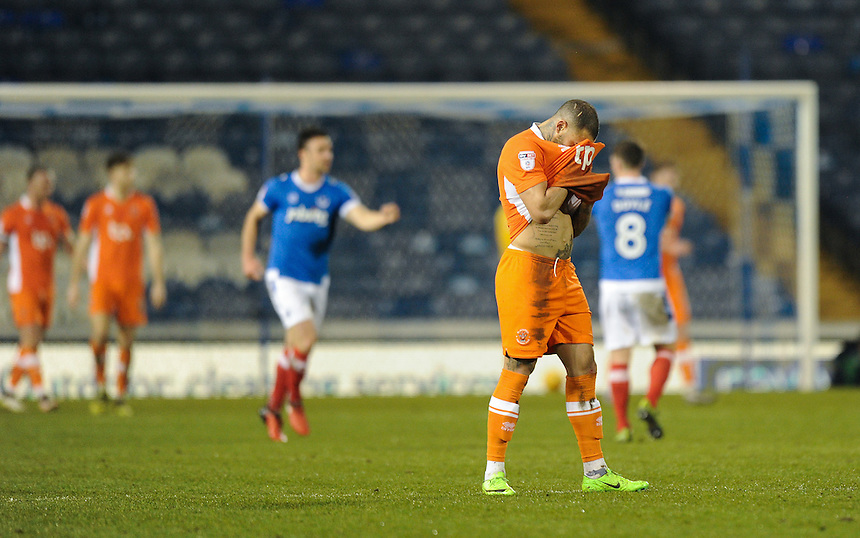 Blackpool's Kyle Vassell dejected as Portsmouth's Gareth Evans scores the opening goal <br /> <br /> Photographer Ashley Western/CameraSport<br /> <br /> The EFL Sky Bet League Two - Portsmouth v Blackpool  - Tuesday 14th February 2017 - Fratton Park - Portsmouth<br /> <br /> World Copyright &copy; 2017 CameraSport. All rights reserved. 43 Linden Ave. Countesthorpe. Leicester. England. LE8 5PG - Tel: +44 (0) 116 277 4147 - admin@camerasport.com - www.camerasport.com