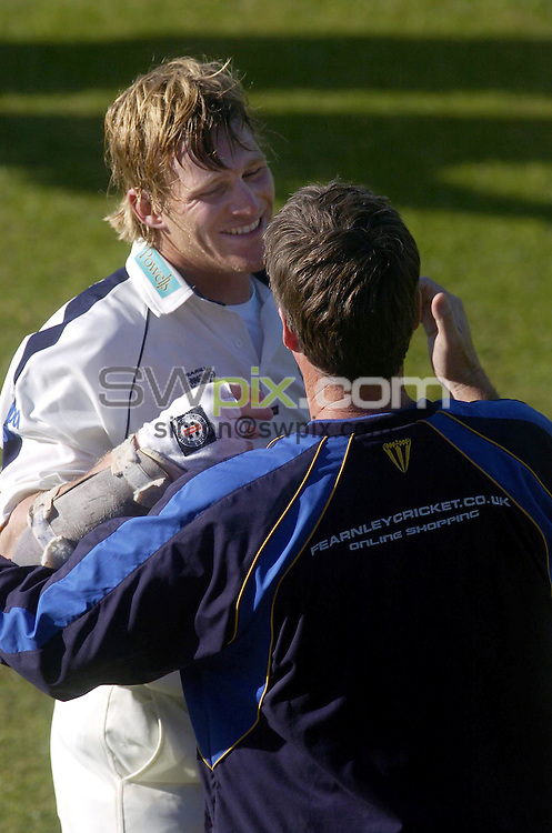 PICTURE BY VAUGHN RIDLEY/SWPIX.COM -  Cricket - Liverpool Victoria County Championship, Day Four - Yorkshire v Hampshire - Headingley, Leeds, England - 03/06/06...? Simon Wilkinson - 07811 267706...Hampshire's James Adams is congratulated by his coach after hitting the winning runs in Hampshire's successful second inning run chase.