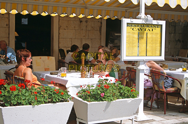 Diners talking at table in outdoor restaurant, menu, Cavtat, near Dubrovnik, Dalmatian Coast, Croatia, Former Yugoslavia