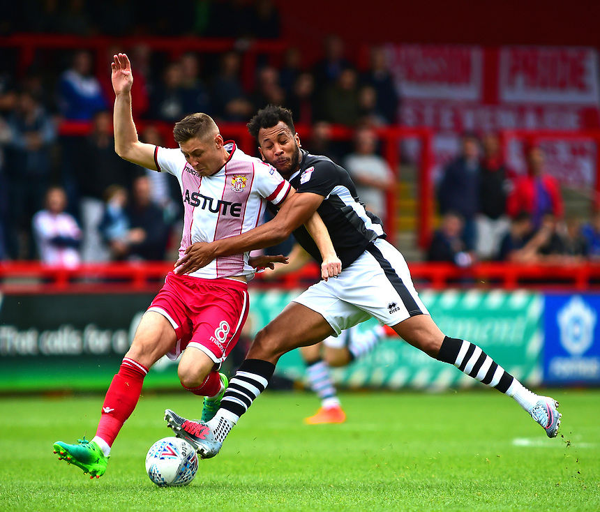 Lincoln City's Matt Green vies for possession with Stevenage's Harry Beautyman<br /> <br /> Photographer Andrew Vaughan/CameraSport<br /> <br /> The EFL Sky Bet League Two - Stevenage v Lincoln City - Saturday 9th September 2017 - The Lamex Stadium - Stevenage<br /> <br /> World Copyright &copy; 2017 CameraSport. All rights reserved. 43 Linden Ave. Countesthorpe. Leicester. England. LE8 5PG - Tel: +44 (0) 116 277 4147 - admin@camerasport.com - www.camerasport.com