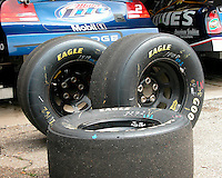 SYNTHETIC RUBBER<br /> NASCAR Racing Tires<br /> Variations Available<br /> The tire compound balances the need for speed from a softer compound with durability from a harder compound.  The tires have no tread because on a dry track, tires can generate more traction if more of their sticky rubber is in contact with the ground.