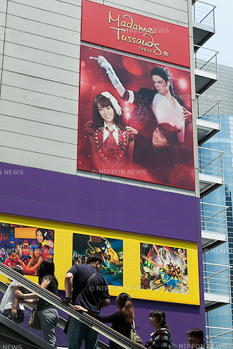 Visitors look at a big advertisement on display outside the Madame Tussauds Tokyo wax museum in Odaiba, Tokyo, June 15, 2015. The world famous British wax museum ''Madame Tussauds'' opened its 14th permanent branch in Tokyo in 2013 and exhibits international and local celebrities, sports players and politicians. New additions to the collection include wax figures of the Japanese figure skater Yuzuru Hanyu and the actor Benedict Cumberbatch. The wax figure of Benedict Cumberbatch will be exhibited until June 30th. (Photo by Rodrigo Reyes Marin/AFLO)