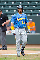 Jorge Alfaro (24) of the Myrtle Beach Pelicans walks back to the dugout after striking out against the Winston-Salem Dash at BB&T Ballpark on May 7, 2014 in Winston-Salem, North Carolina.  The Pelicans defeated the Dash 5-4 in 11 innings.  (Brian Westerholt/Four Seam Images)