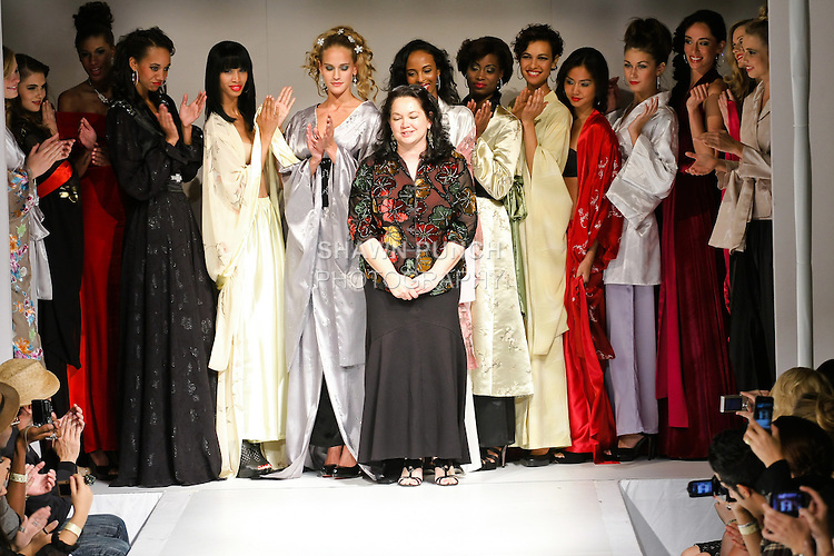 Fashion designer Telina Webb poses with models at the close of her KabukiU Spring Summer 2011 collection fashion show, during Nolcha Fashion Week, September 14, 2010.