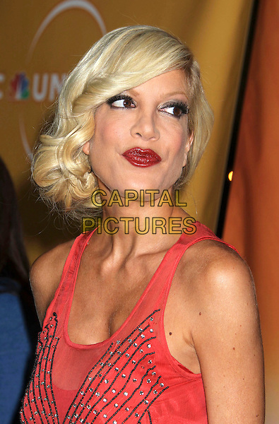 TORI SPELLING .NBC Universal Press Tour Cocktail Party held at the Langham Hotel,  Pasadena, California, USA, .10th January 2010..portrait headshot sleeveless mesh sheer red lipstick make-up .CAP/ADM/MJ.©Michael Jade/AdMedia/Capital Pictures.
