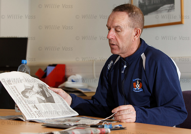 Kilmarnock manager Kenny Shiels checking the newspapers in his office as he checks up on news from home
