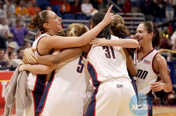 31 MAR 2002:  UCONN guards Diana Taurasi (3) (left) and Sue Bird (10, right) join the celebration after defeating the University of Oklahoma during the Division 1 Women's Basketball Championship held at the Alamodome in San Antonio, TX.  UCONN defeated Oklahoma 82-70 for the national title.  Jamie Schwaberow/NCAA Photos