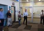 Microsoft president and chief legal officer Brad Smith walks with Fernley middle school student Sky Yi in Fernley, Nevada on Tuesday, July 18 2017.