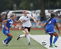 Portland Thorns FC defender Nikki Marshall (7) brings the ball forward as Boston Breakers forward Kyah Simon (17) defends. In a National Women's Soccer League (NWSL) match, Portland Thorns FC (white/black) defeated Boston Breakers (blue), 2-1, at Dilboy Stadium on July 21, 2013.