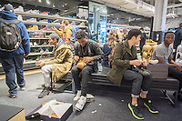 Customers crowd the new Nike flagship store on opening day in Soho in New York on Friday, November 18, 2016. Nike is the largest global athletic shoe and clothing maker. (© Richard B. Levine)