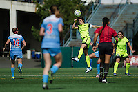 Seattle, WA - Sunday, May 22, 2016: Seattle Reign FC midfielder Keelin Winters (11) goes up for a header during a regular season National Women's Soccer League (NWSL) match at Memorial Stadium. Chicago Red Stars won 2-1.