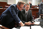 Nevada Lt. Gov. Mark Hutchison, left, and Sen. Scott Hammond talk on the Sente floor at the Legislative Building in Carson City, Nev., on Monday, April 20, 2015. <br /> Photo by Cathleen Allison