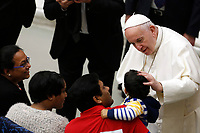 Pope Francis greets a child at the end of his weekly general audience in the Paul VI hall at the Vatican, January 22, 2020.<br /> UPDATE IMAGES PRESS/Riccardo De Luca<br /> STRICTLY ONLY FOR EDITORIAL USE