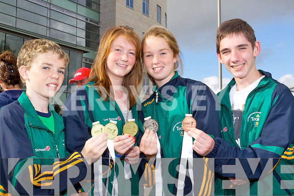 BRINGING HOME THE SILVERWARE: Arriving home to Tralee on Monday evening after their success trip to the International Children's Games in Lanarkshire, Scotland were l-r: Killian Brosnan, Ballymac who won 2 gold medals in judo, Sarah Fitzgerald, Ardfert who won a gold medal in golf, Aoife Crowley, Spa who won a silver in golf and Ryan O'Sullivan, Farranfore who won a bronze in judo.