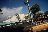 "A man drives his car from the parking lot of the shopping center that hosts ""the Clam Chowder"", a restaurant where Senator Obama used to enjoy meals in Honolulu, Hawaii, United States on thursday July  31 2008..Senator Barack Obama, the presumptive 2008 Democratic presidential candidate was born in Hawaii and spending in he State most of his childhood and teen years. He  graduated from Hololulu's Punahou coeducational college preparatory day school in 1979."