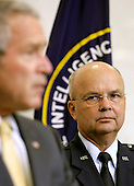 Langley, VA - May 31, 2006 -- New Central Intelligence Agency (CIA) Director General Michael Hayden listens as United States President George W. Bush speaks during his ceremonial swearing in at CIA headquarters in Langley, Virginia Wednesday 31 May 2006. Hayden, the former head of the super-secret National Security Agency (NSA), was officially sworn-in by National Intelligence Director John Negroponte in a closed ceremony.<br /> Credit: Matthew Cavanaugh-Pool via CNP