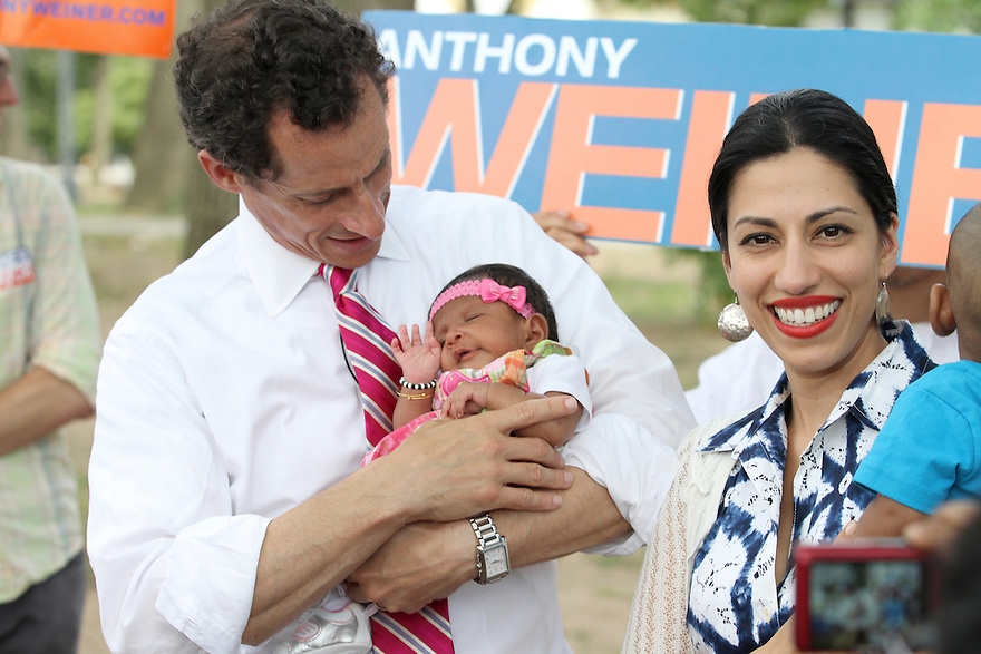 Anthony Weiner along with wife Huma Abedin attend the Jamaica Jerk Festival at Roy Wilkins Park in Queens on Sunday, July 21, 2013. (AP Photo/ Donald Traill)