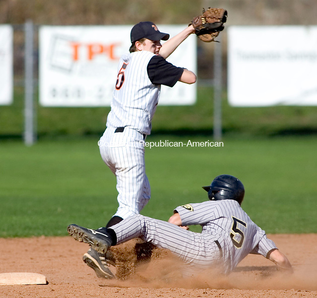 WATERTOWN, CT- 30 APRIL 07- 043007JT09-<br /> Woodland's Cody Kingsley slides safely to second as Watertown's Roger Ouellette covers the bag during Monday's game at Deland Field in Watertown. Woodland won 7-3.<br /> Josalee Thrift Republican-American