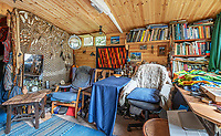 BNPS.co.uk (01202 558833)<br /> Pic: Symonds&Sampson/BNPS<br /> <br /> Rustic charm...<br /> <br /> £125,000 - For your own idyllic rustic hideaway...<br /> <br /> Fancy the unique chance to own a remote woodland shack in its own private valley near Lyme Regis in Dorset?<br /> <br /> The timber chalet, with a pond, decking and a log bridge across a stream, is buried in the middle of 10 acres of private woodland near the seaside resort.<br /> <br /> The primitive but eco-friendly chalet can be slept it overnight but can't be used as a permanent residence.