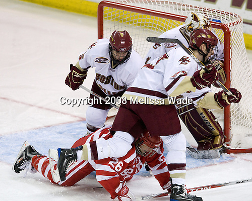 Joe Whitney (Boston College - 15), Luke Popko (Boston University - 26), Andrew Orpik (Boston College - 27), John Muse (Boston College - 1) - The Boston University Terriers defeated the Boston College Eagles 3-1 at Kelley Rink in Conte Forum in Chestnut Hill, Massachusetts.