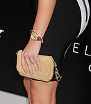 WESTWOOD, CA- AUGUST 07: Actress Emily Osment (handbag, jewelry detail) at the Los Angeles premiere of 'Elysium' at Regency Village Theatre on August 7, 2013 in Westwood, California.