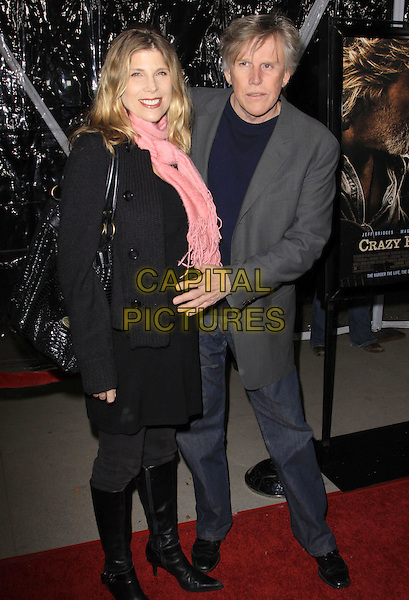 """GARY BUSY (R) & girlfriend Stephanie .""""Crazy Heart"""" - Los Angeles Premieres held Academy of Motion Picture Arts and Sciences, Beverly Hills, California, USA..December 8th, 2009.full length couple peach pink scarf black grey gray suit jacket jeans knee high boots hand .CAP/ADM/KB.©Kevan Brooks/AdMedia/Capital Pictures."""