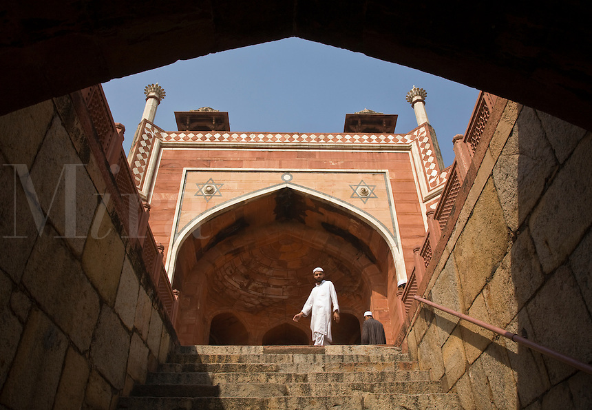 MUSLIM MAN at HUMAYUN'S TOMB which was built of white marble and red sandstone in1565 and is a fine example of MUGHAL architecture - NEW DELHI, INDIA