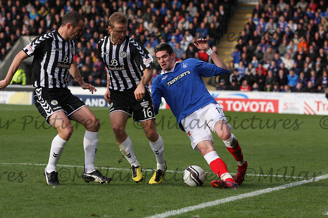 Kyle Lafferty challenged by Jure Travner and another