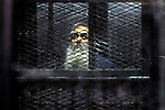 Egypt's Salafi leader and former presidential candidate Hazem Salah Abu Ismail looks on from the defendant cage during his trial in Cairo on April 2, 2016. An egyptian court considers today, Saturday the first trial session of Salafist preacher Hazem Salah Abu Ismail and 17 other defendants over charges of imposing Blockade on Nasr City Court. Photo by Amr Sayed