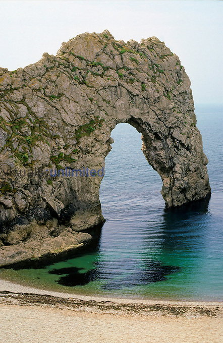 A sea arch in Portland limestone ( Jurassic-Cretaceous) known as Durdle Door. The arch will eventually collapse leaving a stack. West of Lulworth, Dorset, England. Photographer G. R. 'Dick' Roberts © Natural Sciences Image Library.