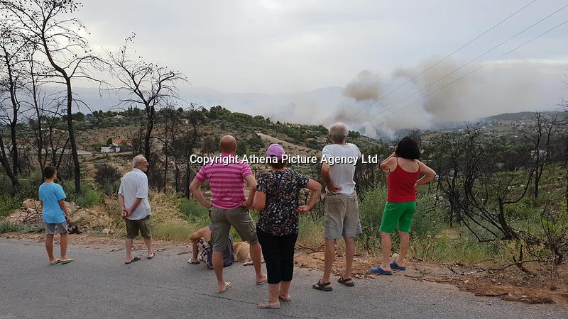 Forest fire in the Agioi Apostoloi village near Kalamos, Greece. 23 July 2018
