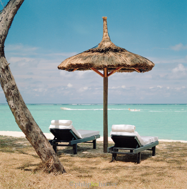 Sun loungers on the beach at Le Touessrok Resort, Mauritius