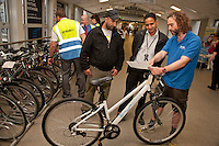 Keeping Derby Moving is the slogan of Connected, who were promoting their sustainable travel programme at Derby Train Station. Pictured is John Hughes of LifeCycle UK awith Satnam Chaira (left) and Gurcharan Girn who were looking at recycled bikes from the Station's Lost Property whcih have been refurbished by prisoners in a work programme.