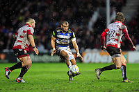 Jonathan Joseph of Bath Rugby puts boot to ball. Aviva Premiership match, between Gloucester Rugby and Bath Rugby on March 26, 2016 at Kingsholm Stadium in Gloucester, England. Photo by: Patrick Khachfe / Onside Images