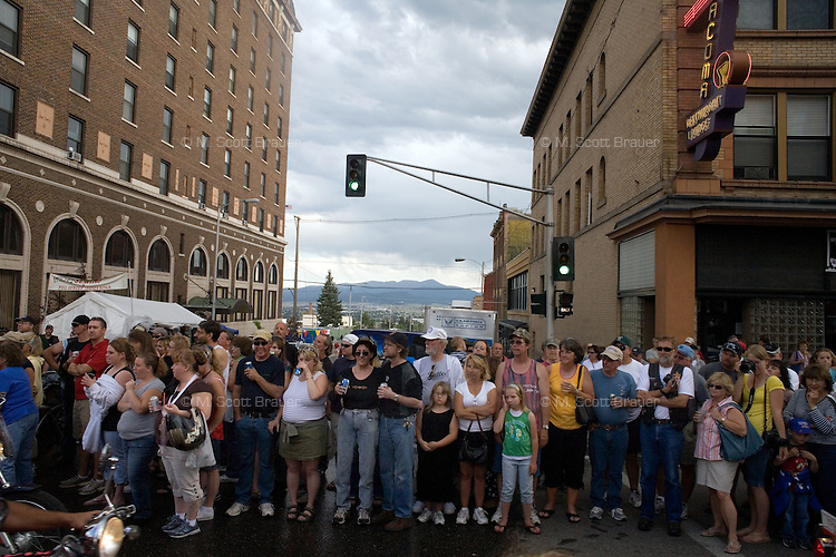 Crowds gather in downtown Butte, Montana, USA, to watch motorcycles drive by during the Evel Knievel Days festival.
