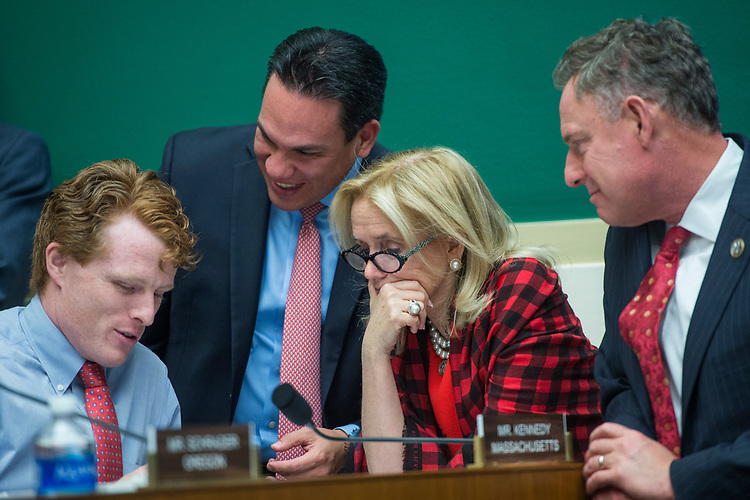 UNITED STATES - MARCH 9: From left, Reps. Joe Kennedy III, D-Mass., Pete Aguilar, D-Calif., Debbie Dingell, D-Mich., and Scott Peters, D-Calif., confer after the 24-hour mark of a House Energy and Commerce Committee markup in Rayburn Building regarding the bill to repeal and replace the the Affordable Care Act, March 9, 2017. (Photo By Tom Williams/CQ Roll Call)